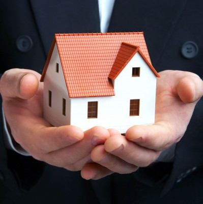Property manager holding a house