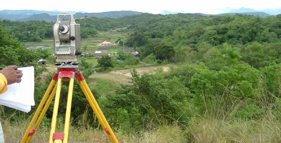 Man performing land survey