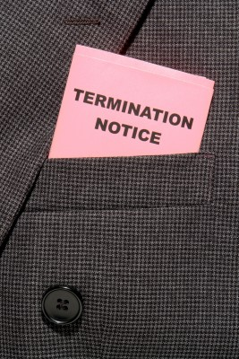 A pink termination notice slip in tucked in someones coat sleeve